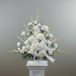 Dignity in White Pedestal Arrangement